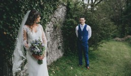 Bride & Groom looking lovingly at each other at welsh wedding venue