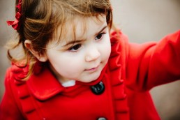 Beautiful little girl having a family photography session at cosmeston lakes