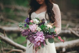 Bride with stunning bouquet in the woods