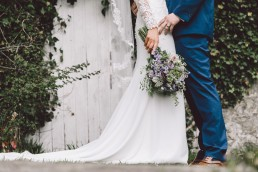 Stunning Wedding Photography - Bride & Groom with lavender bouquet
