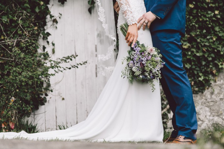 Stunning Wedding Photography - Bride & Groom with lavender bouquet at Court Colman Manor