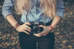 Cardiff Documentary Wedding Photographer Francesca Hill Holding A Camera
