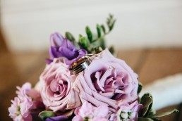 Wedding rings on beautiful pastel bouquet