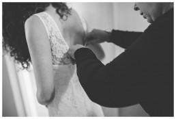 Wedding Photographer Cardiff - Bride putting her dress on