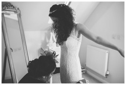 Wedding Photographer Cardiff - Bride putting her dress on