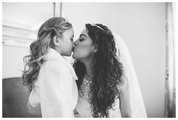 Wedding Photographer Cardiff - Bride and kids getting emotional