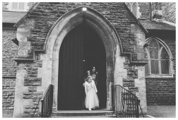 Wedding Photographer Cardiff - Bridesmaids awaiting arrival of bride at the church
