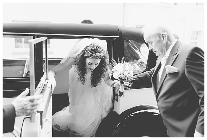 Wedding Photographer Cardiff - Bride getting out of the wedding car