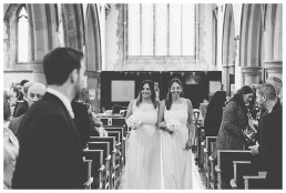 Wedding Photographer Cardiff - Bridesmaids walking down the aisle