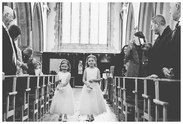 Wedding Photographer Cardiff - Bridesmaids walking down the aisle