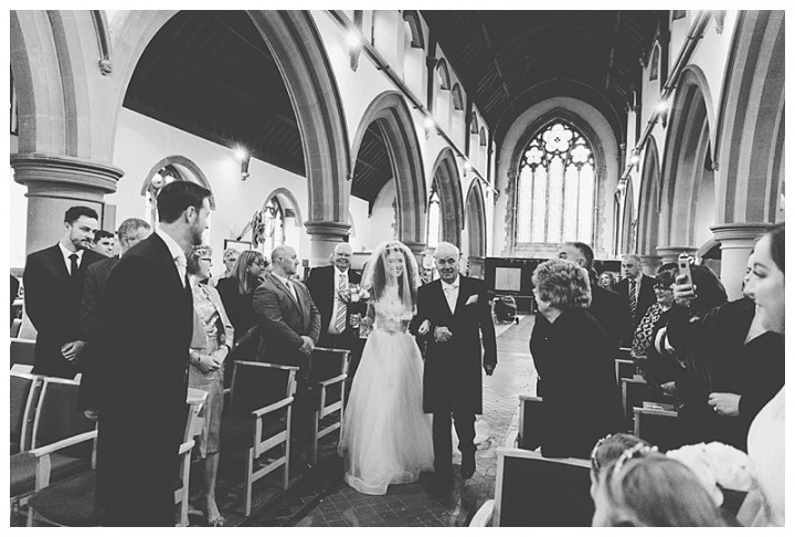 Wedding Photographer Cardiff - Groom sees his smiling bride walking down the aisle
