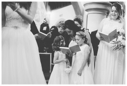Wedding Photographer Cardiff - Flower girls singing hymns in church