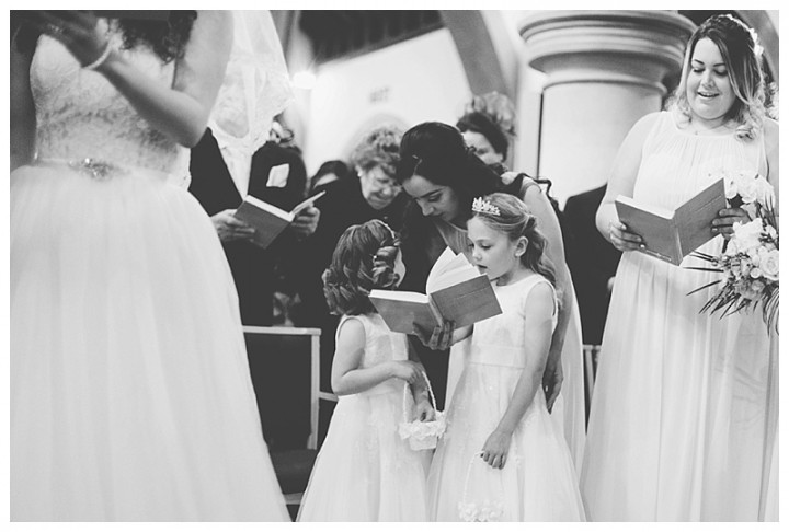 Wedding Photographer Cardiff - Flower girls singing hymns in church