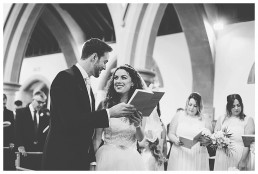 Wedding Photographer Cardiff - Couple exchanging rings
