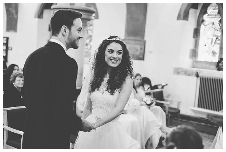 Wedding Photographer Cardiff - Couple exchanging rings
