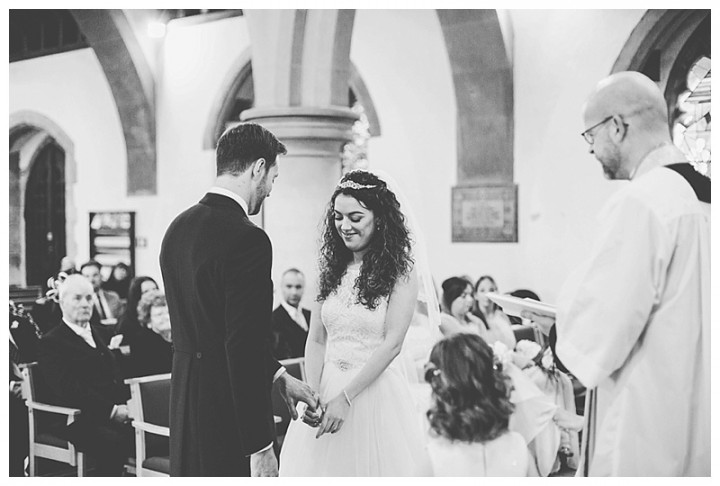 Wedding Photographer Cardiff - Newly married couple smiling at church alta
