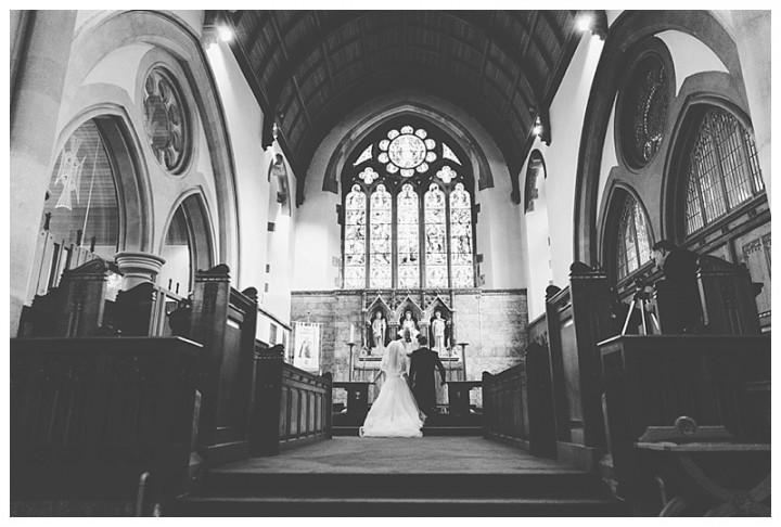 Wedding Photographer Cardiff - Couple kneeling at the altar