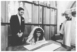 Wedding Photographer Cardiff - Couple signing the register