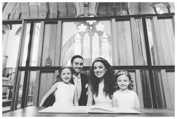 Wedding Photographer Cardiff - Family posing for a shot with the register