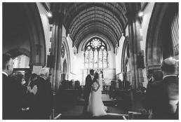 Wedding Photographer Cardiff - Couple kissing at the altar