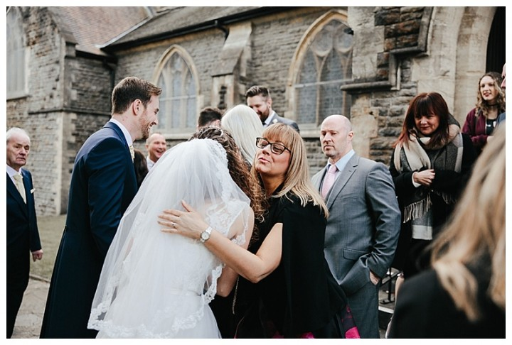 Wedding Photographer Cardiff -Bride being congratulated by wedding guests