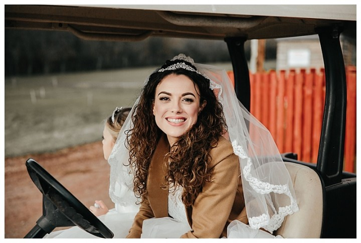 Beautiful smiling bride in golf buggy at Cardiff wedding