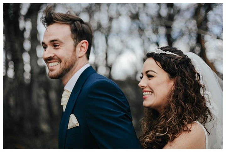 newly wed couple laughing during Cardiff wedding photos
