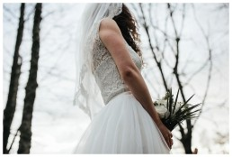Close up of brides dress and the woods in Caerphilly