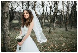 Happy bride smiling at the camera