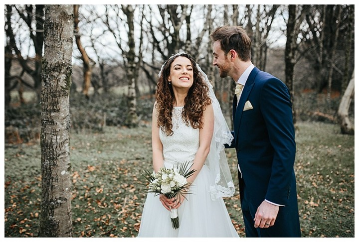 Laughing and smiling between the newlyweds at Cardiff wedding