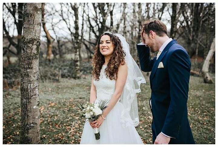 Bride laughing during wedding photos at Cardiff wedding