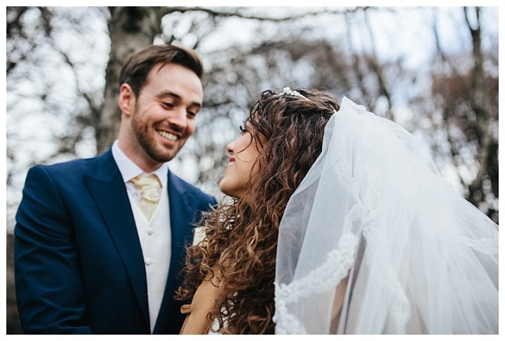 Newly married couple enjoy a laugh during their wedding photos in Cardiff