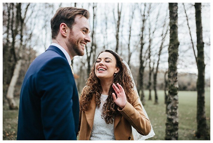 Newly married couple laughing at Cardiff wedding photographer
