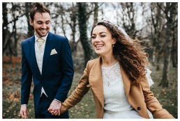 Bride laughing during wedding photography in Caerphilly