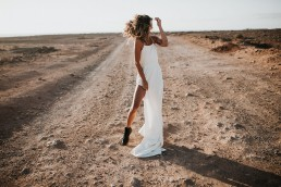 Elopement wedding - bride stood on abandoned road in lanzarote