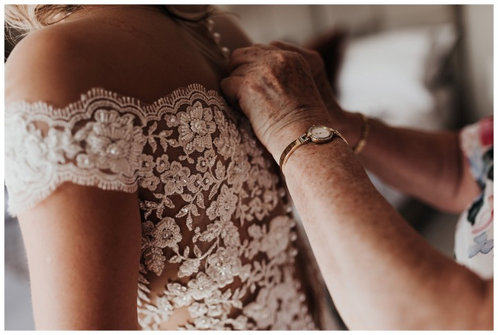 Close up of brides dress as she's getting ready