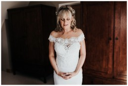 bride just after she's put on her wedding dress