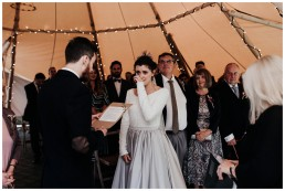 groom saying his vows in tipi wedding at fforest