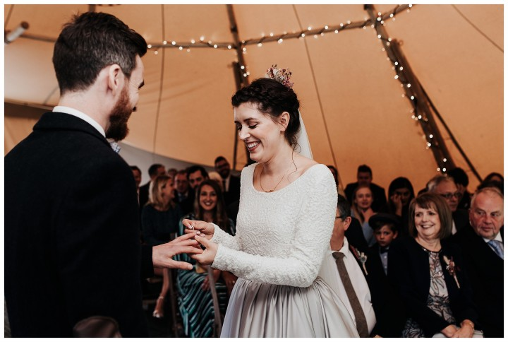 bride saying her vows in tipi wedding at fforest