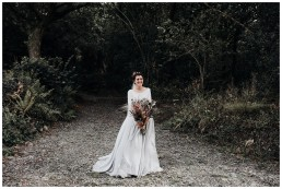 bride posing with her flowers at fforest
