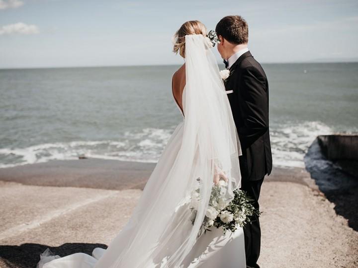 Bride & Groom looking at the waves on Llantwit Major beach