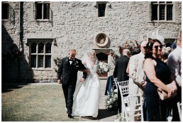 bride walking down the aisle in outdoor ceremony at st donats