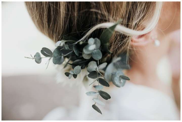 close up photo of brides floral hair piece