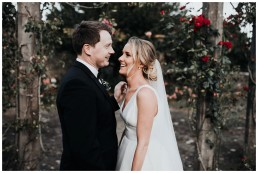 bride and groom laughing during wedding photo session