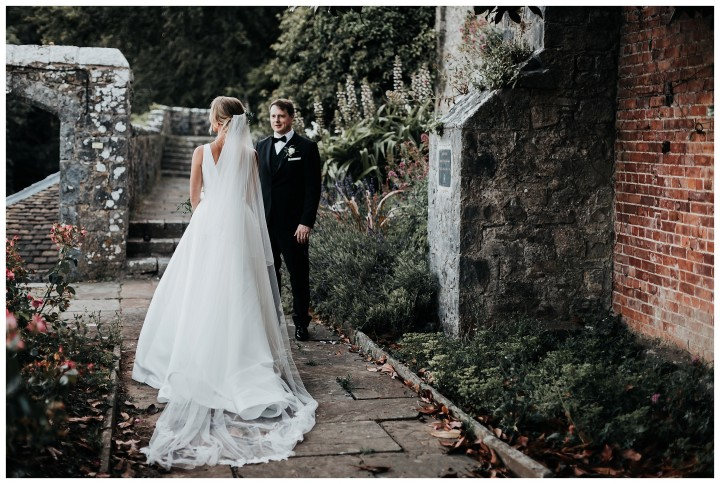 bride and groom posing in the walled garden at st donats castle