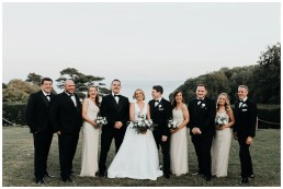 bridal party laughing on the lawn at st donats