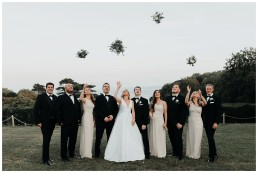 bridal party throwing their bouquets at st donats castle