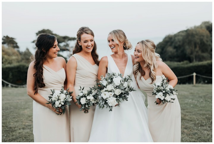 bridesmaids smiling at each other at st donats