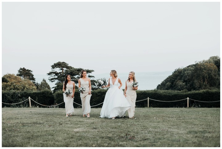 bridesmaids running on the lawn at st donats castle